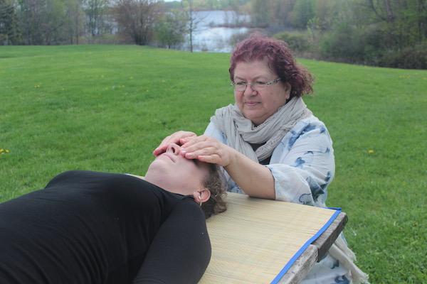 Reiki hands on healing on head