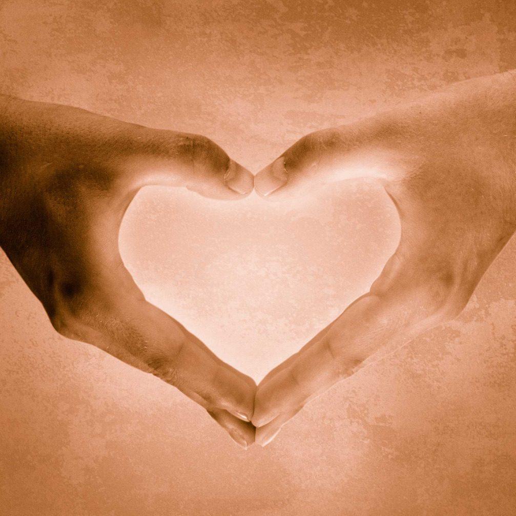 hands making a heart shape.